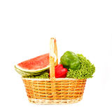 Watermelon and seasonal vegetables in wicker basket Stock Images