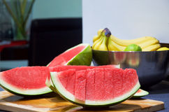 Watermelon without seeds ready to eat on wooden table Royalty Free Stock Image