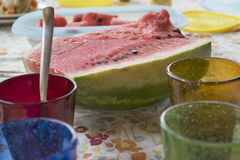 Watermelon on a set table Royalty Free Stock Image