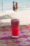 Watermelon shake on tropical beach. Natural light photo of watermelon shake on tropical beach, shallow DOF view 2 Stock Photography