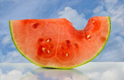 Watermelon with sky reflection Stock Images
