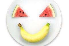 Watermelon slice and banana smiling faces Stock Photo