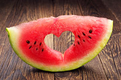 Watermelon slice with cut in the shape of heart Royalty Free Stock Images