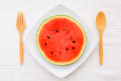 Watermelon slice on a dish. A fresh watermelon slice on a tableware Stock Photography