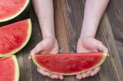 Watermelon. Slice of  in hands Stock Images