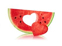 Watermelon Slice with heart hole shaped. On white Royalty Free Stock Image