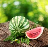Watermelon with a slice and leaves Royalty Free Stock Photo