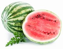 Watermelon with a slice and leaves Stock Image