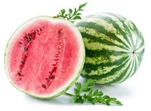 Watermelon with a slice and leaves Royalty Free Stock Images