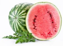 Watermelon with a slice and leaves Stock Images
