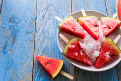 Watermelon slice popsicles on a blue rustic wood background Stock Photography