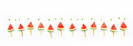 Watermelon slice popsicles and paper mint on white wooden backgr Stock Photo