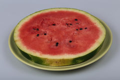 Watermelon. Slice of ripe watermelon on a plate Royalty Free Stock Image