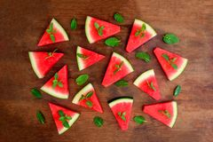 Watermelon slice on rustic wood background. Flat lay. Summertime. Concept stock photos