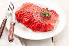 Watermelon slice on white plate Royalty Free Stock Photography