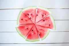Watermelon slice on a white rustic wood background, Popular summer fruit with yummy watermelon, Flat lay photography of Watermelon Royalty Free Stock Images