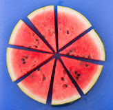 Watermelon sliced on a blue cutting board Royalty Free Stock Photos