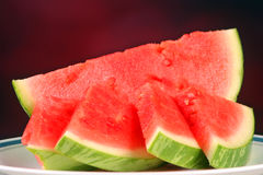 Watermelon slices against a red background Royalty Free Stock Photo