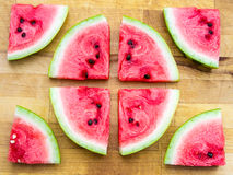 Watermelon slices arranged in a circle shape and around Royalty Free Stock Photos