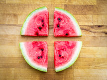Watermelon slices arranged in a circle shape. Fresh fruit rawfood still life on wooden board, useable as background or illustration Stock Images