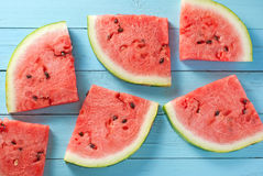 Watermelon slices on blue wood backdrop Royalty Free Stock Photography