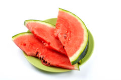Watermelon slices on the green plate Royalty Free Stock Photos