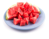 Watermelon slices and pieces on a blue plate Stock Photography