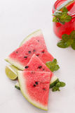 Watermelon slices and punch Royalty Free Stock Photos