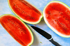 Watermelon slices on rustic blue wooden table Royalty Free Stock Photos