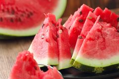 Watermelon slices on the table in summertime Stock Photos