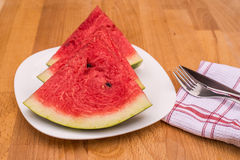 Watermelon slices on the white porcelain plate. Stock Photos