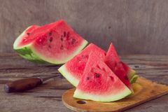 Watermelon slices on the woodan table. Fresh red watermelon. Rus Royalty Free Stock Photos
