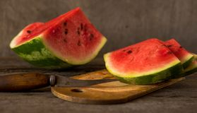 Watermelon slices on the woodan table. Fresh red watermelon. Rus Stock Images