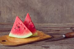 Watermelon slices on the woodan table. Fresh red watermelon. Rus Royalty Free Stock Image