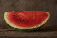 Watermelon slices on the woodan table. Fresh red watermelon. Rus Stock Photo