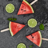 Watermelon slices on wooden stick with lime Royalty Free Stock Photos