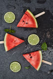 Watermelon slices on wooden stick with lime Stock Photos