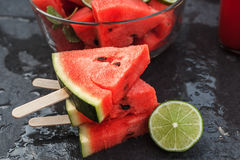 Watermelon slices on wooden stick with lime Stock Photography