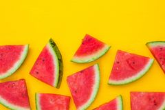 Watermelon slices on yellow background with copy space, summer fruit concept royalty free stock photography