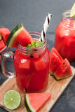 Watermelon smoothie and chips with lime Stock Photos