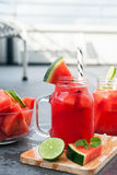 Watermelon smoothie and chips with lime Royalty Free Stock Image