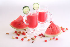 Watermelon smoothie with cucumber and nuts on white background Royalty Free Stock Image