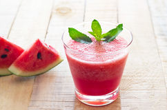 Watermelon smoothie healthy and mint herb on wooden table background Stock Photos