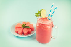 Watermelon smoothie in Mason jar decorated with lime, mint, straws Royalty Free Stock Photos