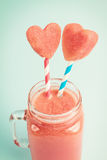 Watermelon smoothie in Mason jar decorated with watermelon heart slices Royalty Free Stock Photo