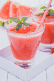 Watermelon smoothie on a white wooden table. Royalty Free Stock Image