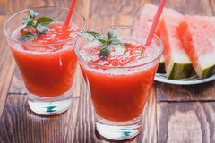 Watermelon smoothie on a wooden table. Royalty Free Stock Images