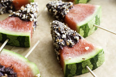 Watermelon snack. With chocolate and nuts Royalty Free Stock Photography