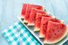 Watermelon Snack Food on Plate in Summer. Watermelon slices on a white plate in summertime Royalty Free Stock Images