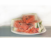 Watermelon in a stretch film coated fridge royalty free stock images